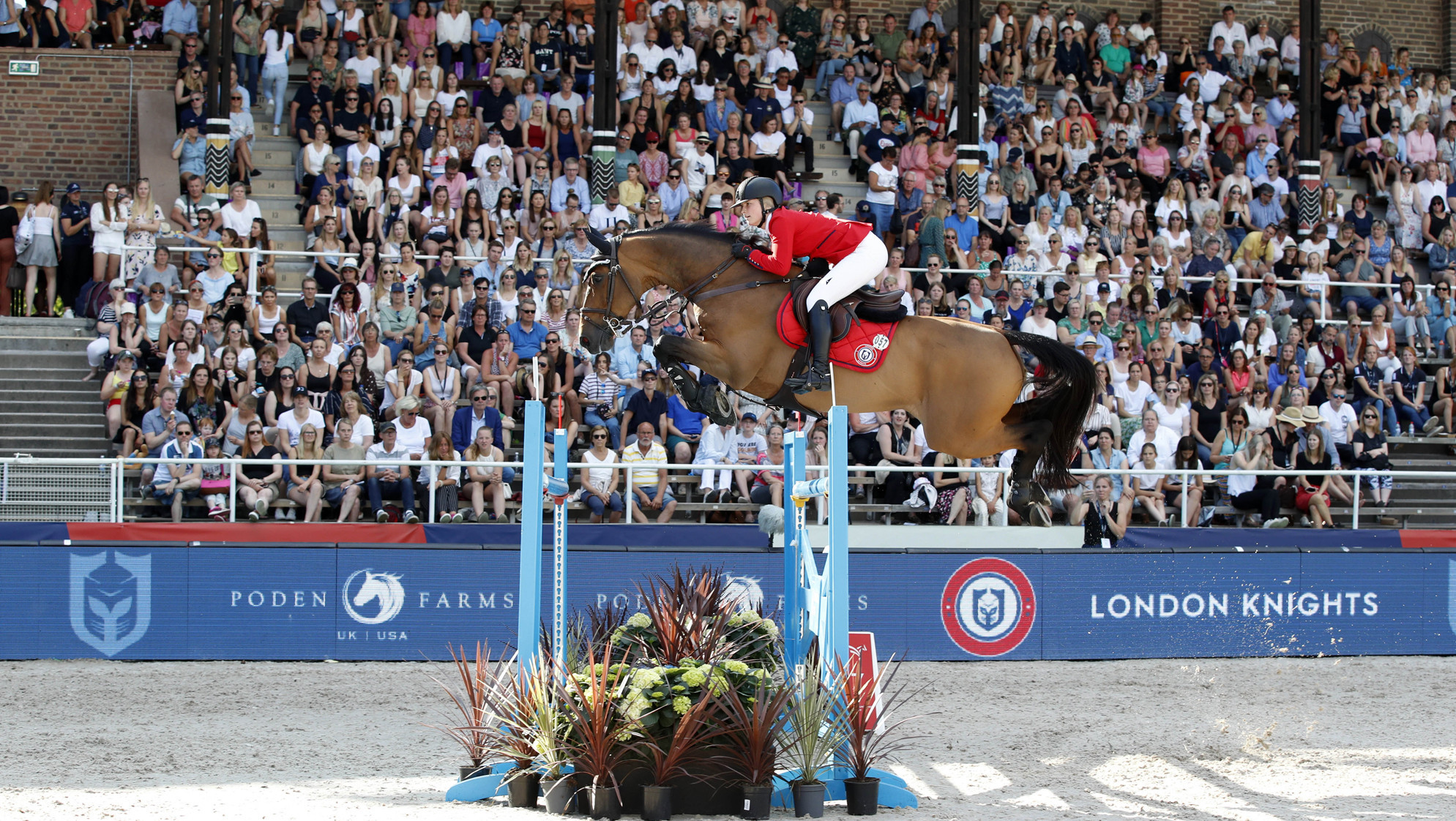 Emily Moffitt completed a faultless ride to help London Knights win the Longines GCL event in Stockholm ©GCL