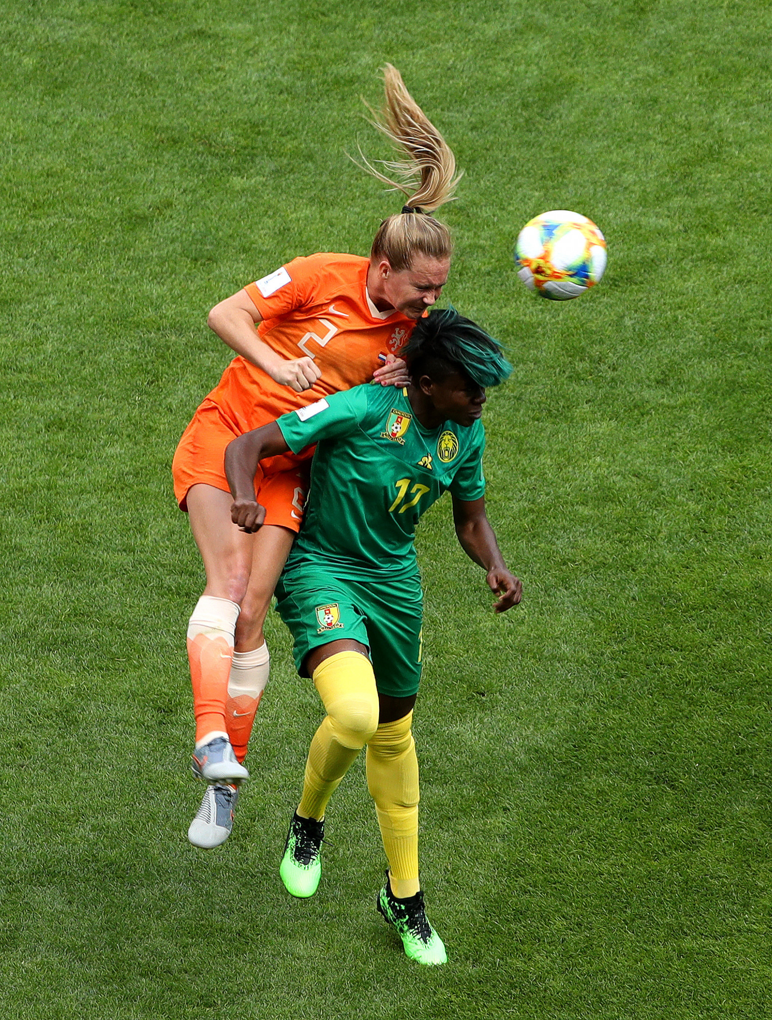 Desiree van Lunteren of the Netherlands competes for a header with Cameroon's Gaelle Enganamouit ©Getty Images
