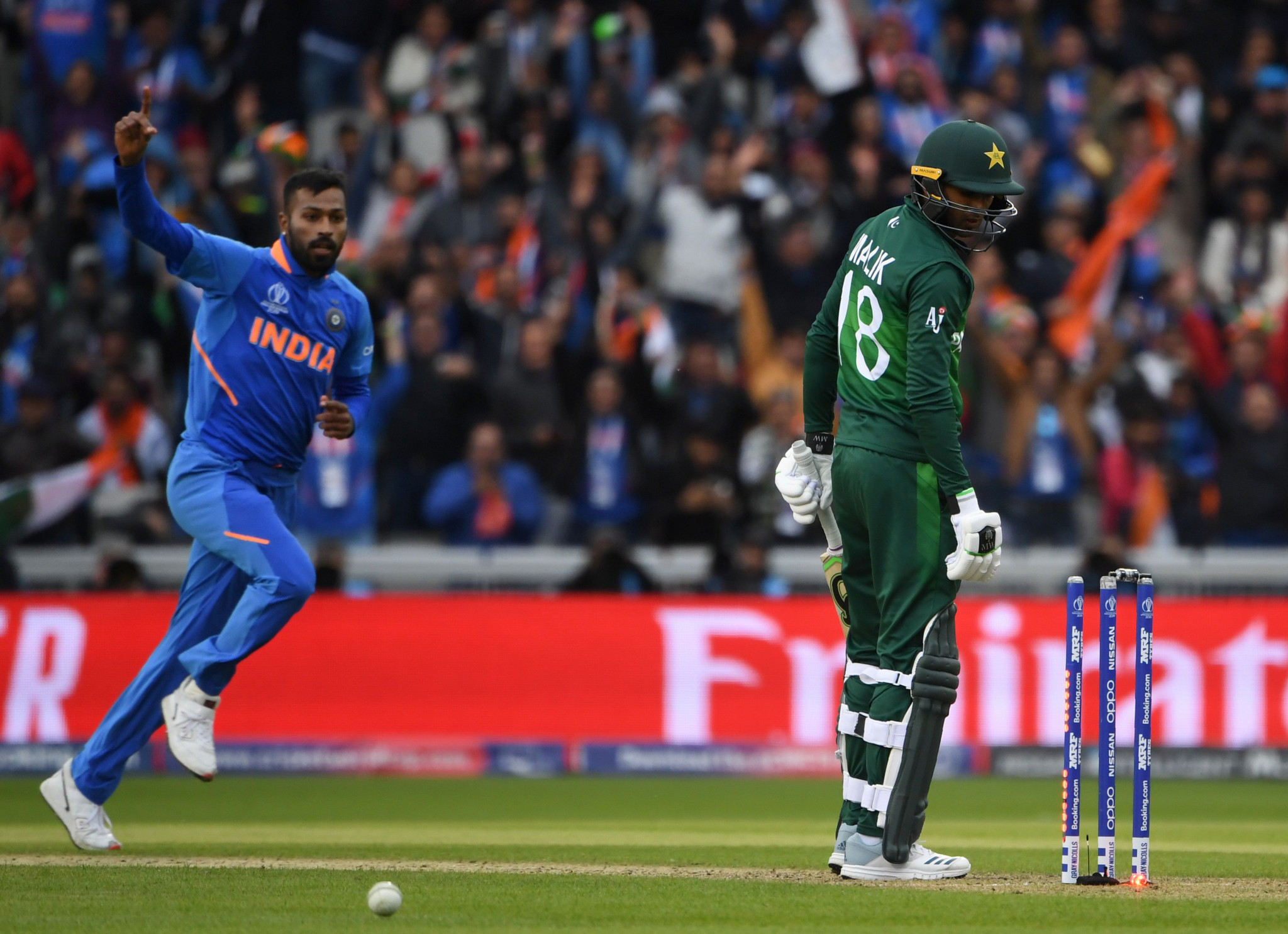 Hardik Pandya, left, and Kuldeep Yadav took two wickets each as India defeated their neighbours and rivals in Manchester © Getty Images