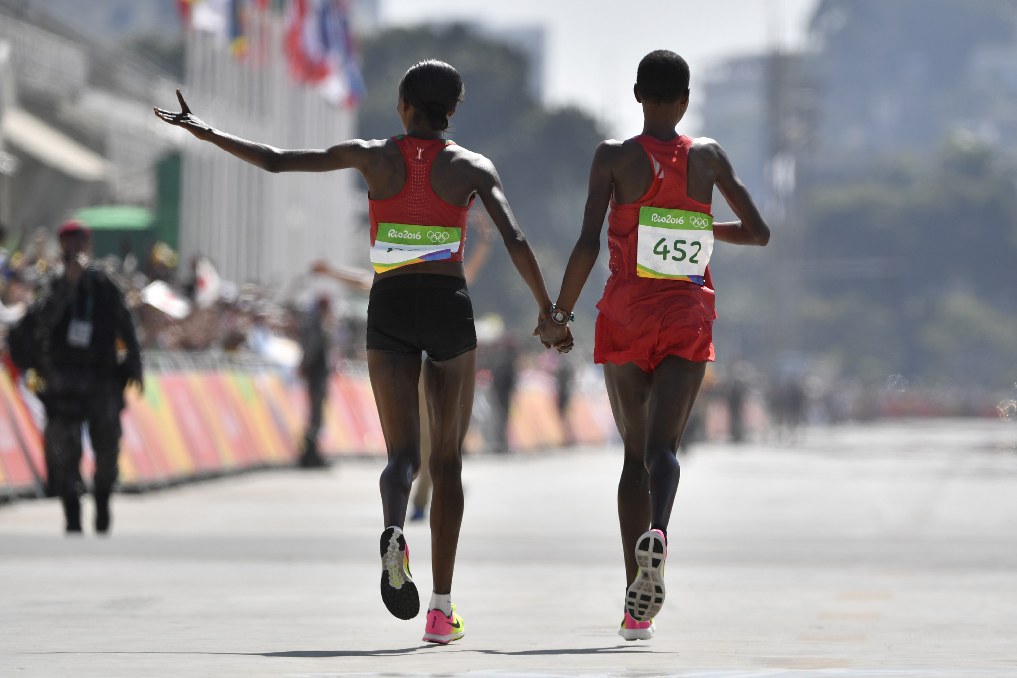 Eunice Kirwa, right, celebrates her Olympic silver medal at Rio 2016 with the winner, former Kenyan team-mate Jemima Sumgong – both are now banned after testing positive for EPO ©Getty Images