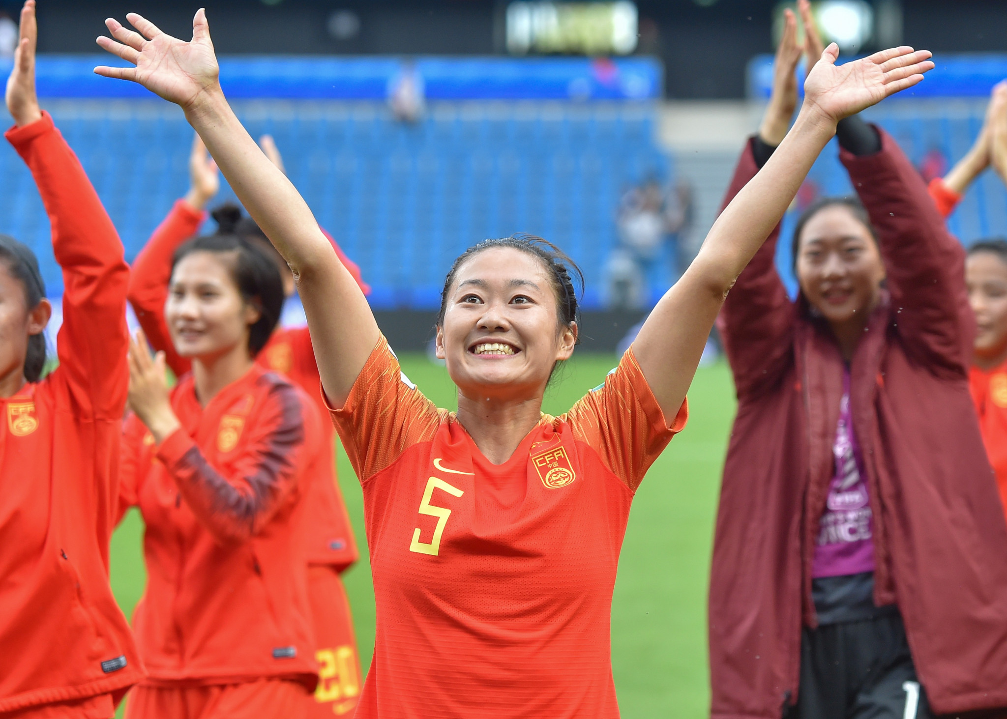 China defender Haiyan Wu, centre, and her team mates celebrate advancing past the group stage following a stalemate with Spain ©Getty Images