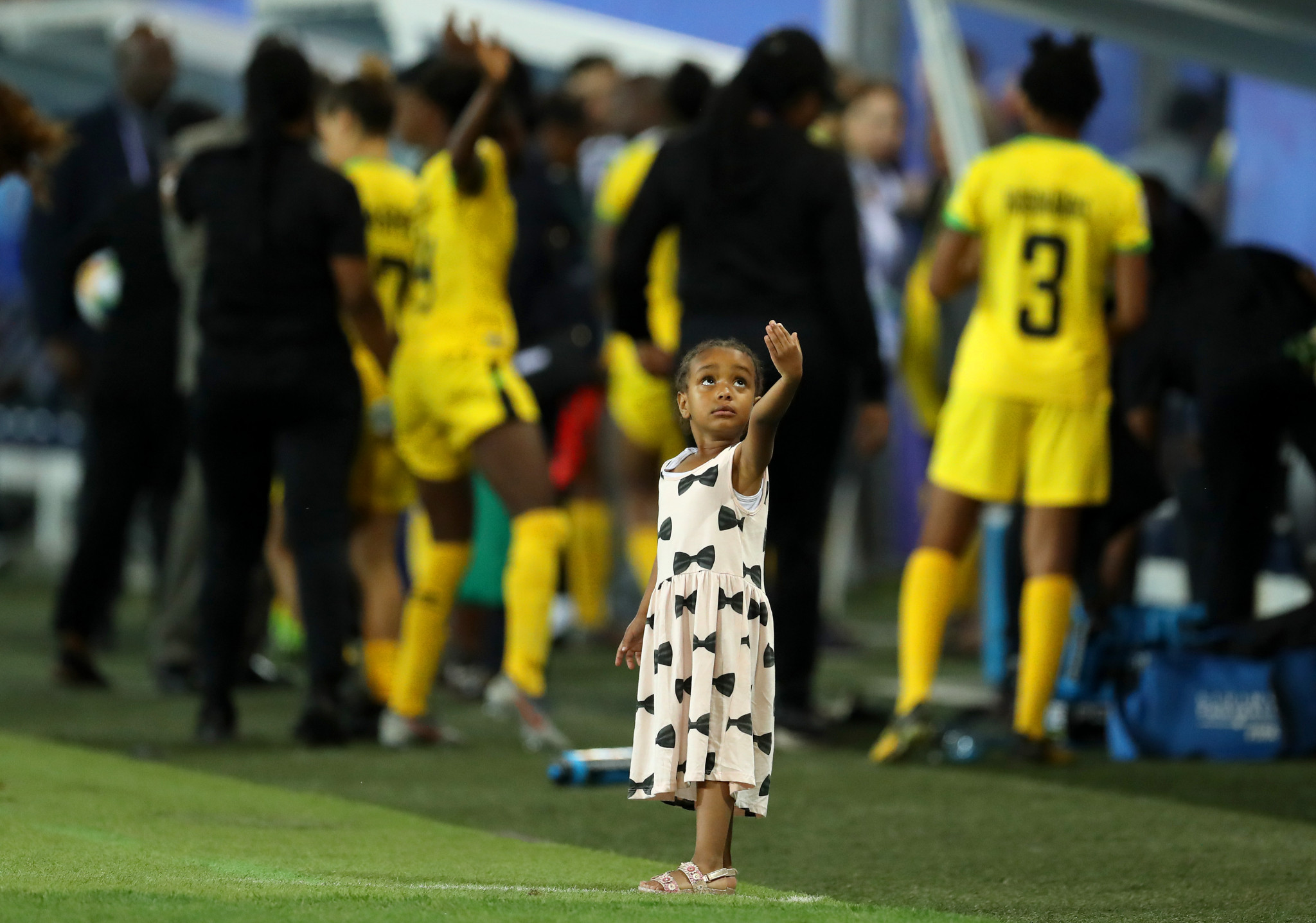 A child dances on the sidelines following Australia's victory over Jamaica ©Getty Images