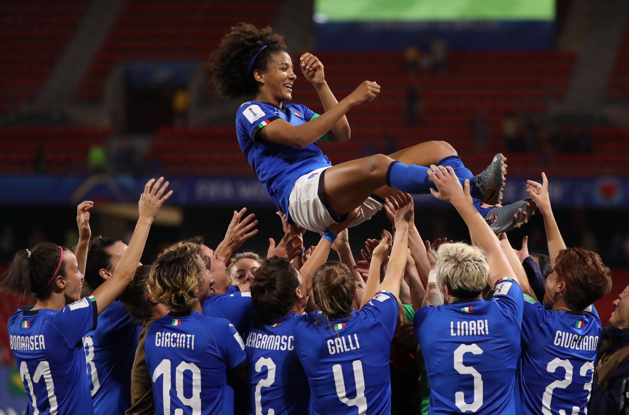 Gama is thrown in the air by her team mates ©Getty Images