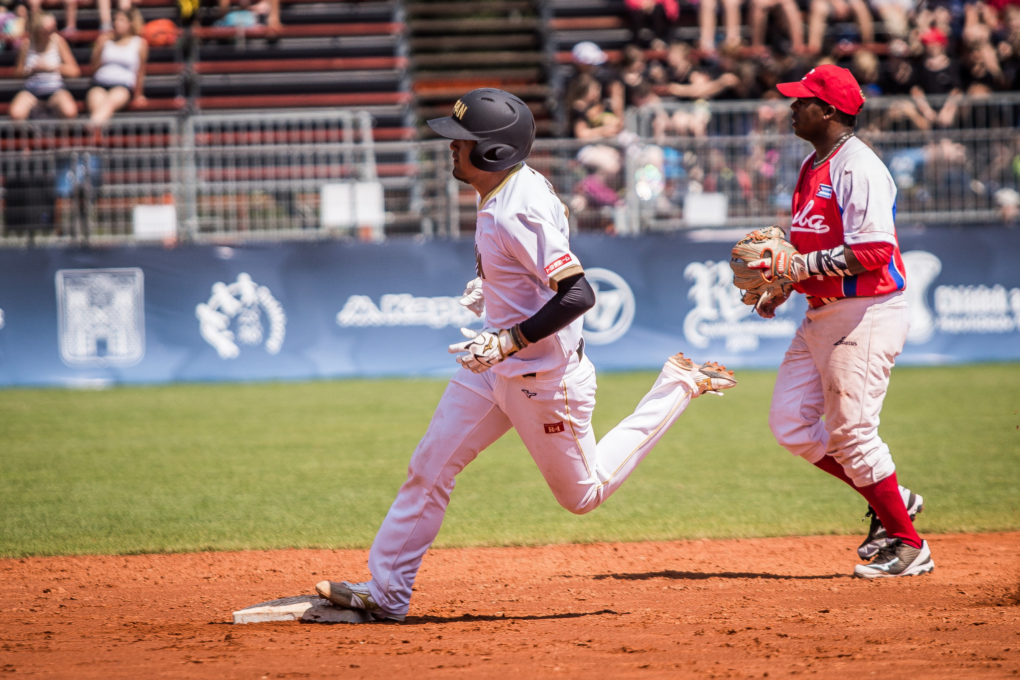 Japan secure top spot in Group A with win over Cuba at WBSC Men's Softball World Championship