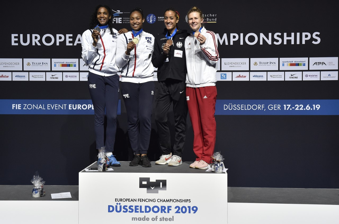 France's Coraline Vitalis tops the podium after winning the women's épée title at the European Fencing Championships in Düsseldorf, beating team-mate Marie-Florence Candassamy in the final ©European Fencing