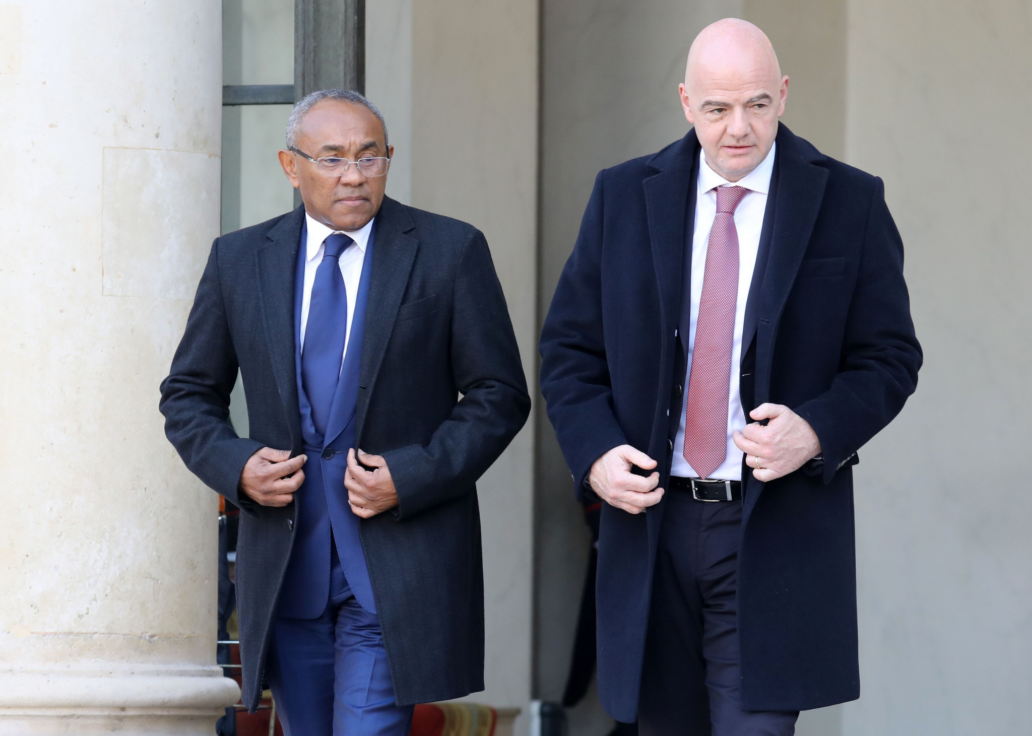 CAF President Ahmad, left, remains under investigation by FIFA's Ethics Committee ©Getty Images