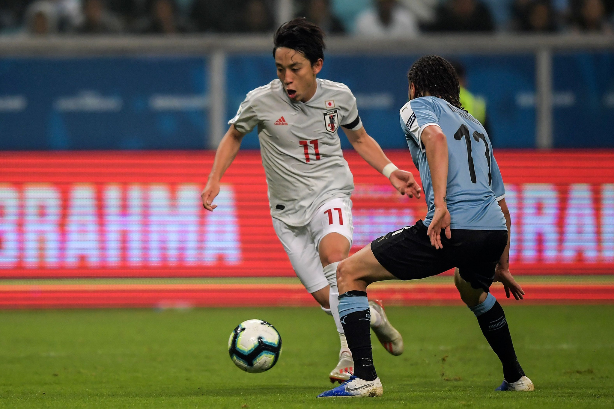 Koji Miyoshi scored twice for Japan as they were held to a draw by Uruguay ©Getty Images