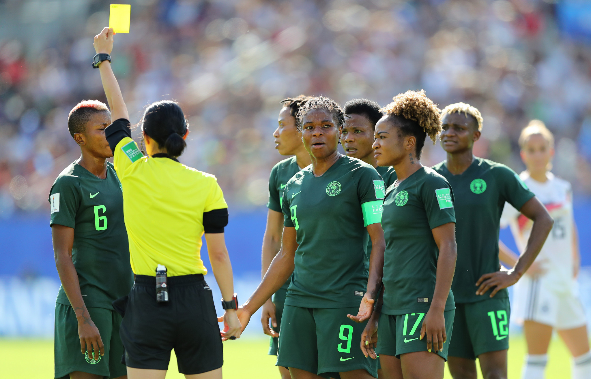 Referee Yoshimi Yamashita shows Evelyn Nwabuoku a yellow card after awarding a penalty against Nigeria via VAR ©Getty Images