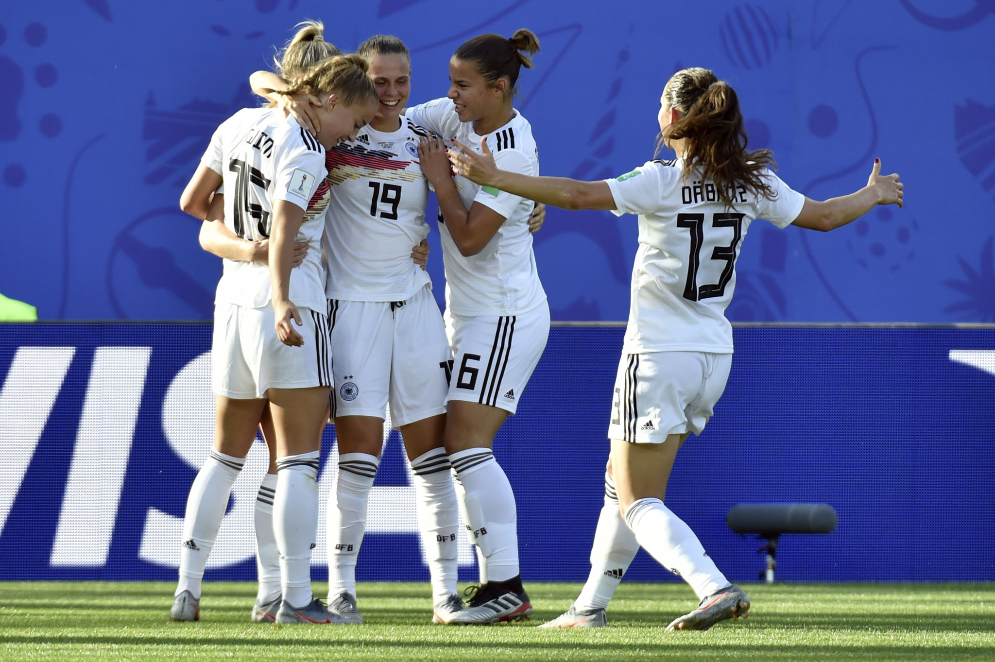 Lea Schuller, hidden, is congratulated by team mates after scoring Germany's third goal ©Getty Images