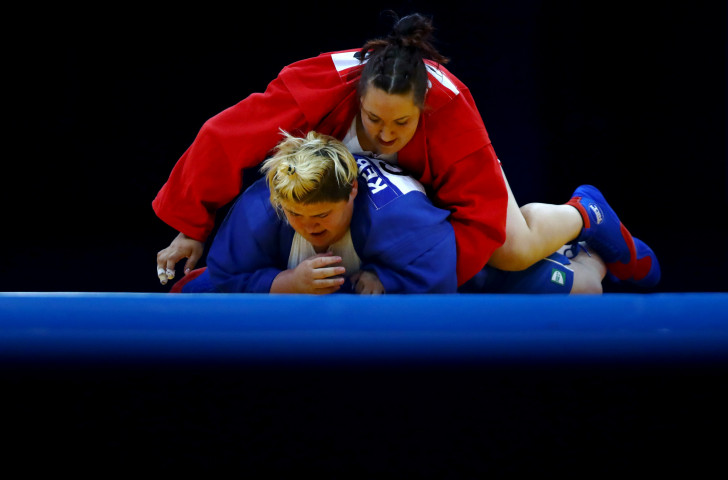 Anastasiia Sapsa of Ukraine, in red, beat Georgia's world champion Elane Kebadze in the final of the women's over-80 kilograms class today ©Getty Images