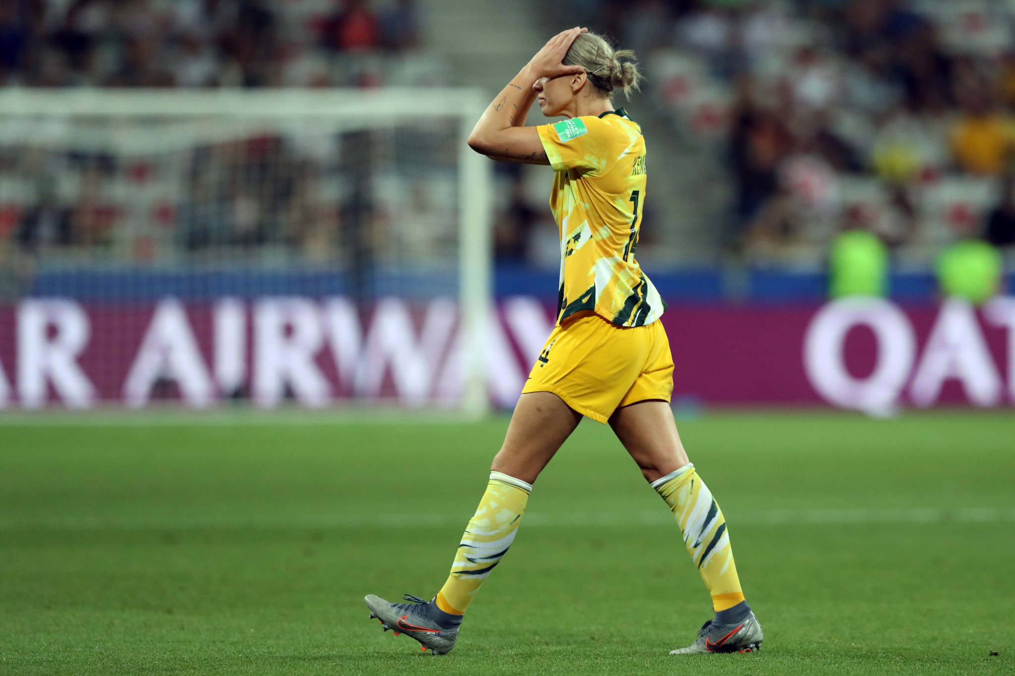 Australia's defender Alanna Kennedy leaves the pitch after getting a red card ©Getty Images