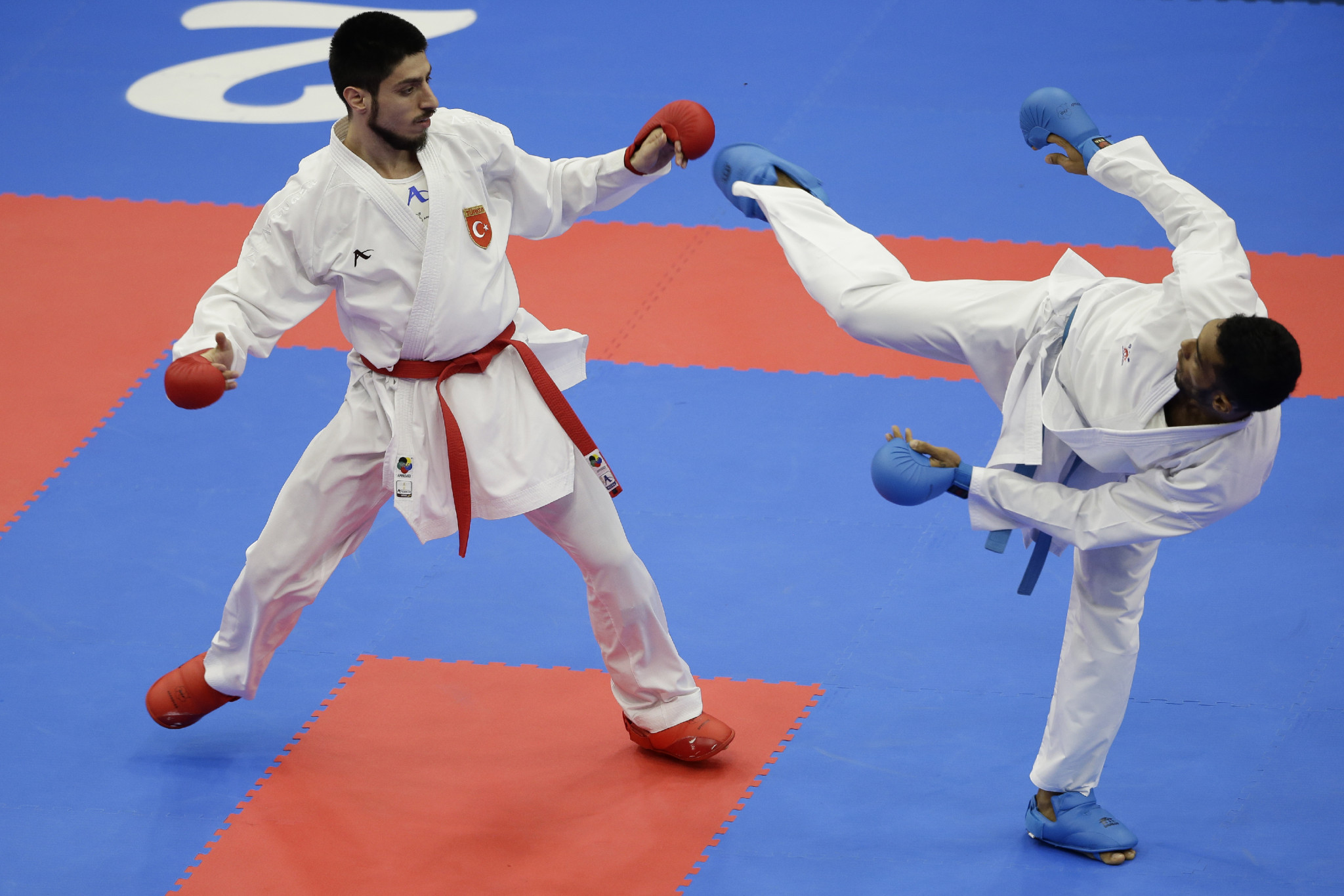 Erman Eltemur, left, knocked out reigning world champion Bahman Asgari Ghoncheh to reach the men's under-75kg final ©Getty Images