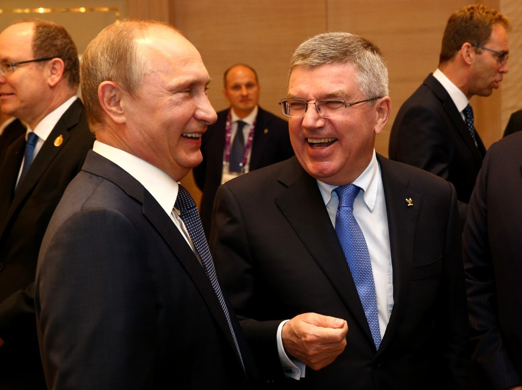 Russian President Vladimir Putin pictured with IOC counterpart Thomas Bach. Russia's state secret police, the FSB, is accused of being involved in systemic Russian doping in the WADA Report ©Getty Images