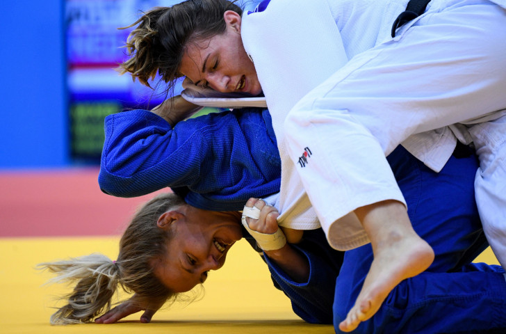Austria's Michaela Polleres, in white, fights against The Netherlands' Juul Franssen during the second mixed team judo tournament bronze final, which went Austria's way ©Getty Images