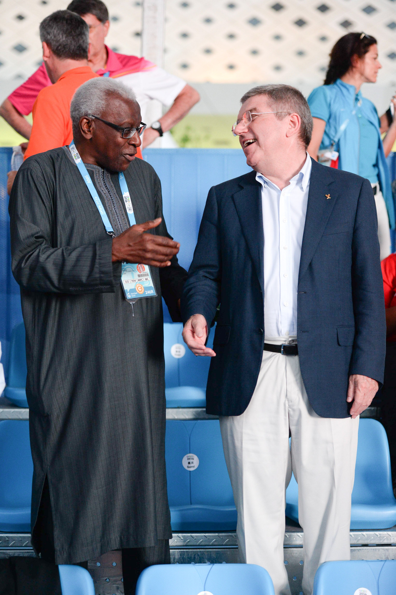 IOC President Thomas Bach, right, has claimed corruption allegations against former IAAF head Lamine Diack, left, have nothing to do with the Summer Youth Olympic Games due to take place in Dakar in 2022 ©Getty Images
