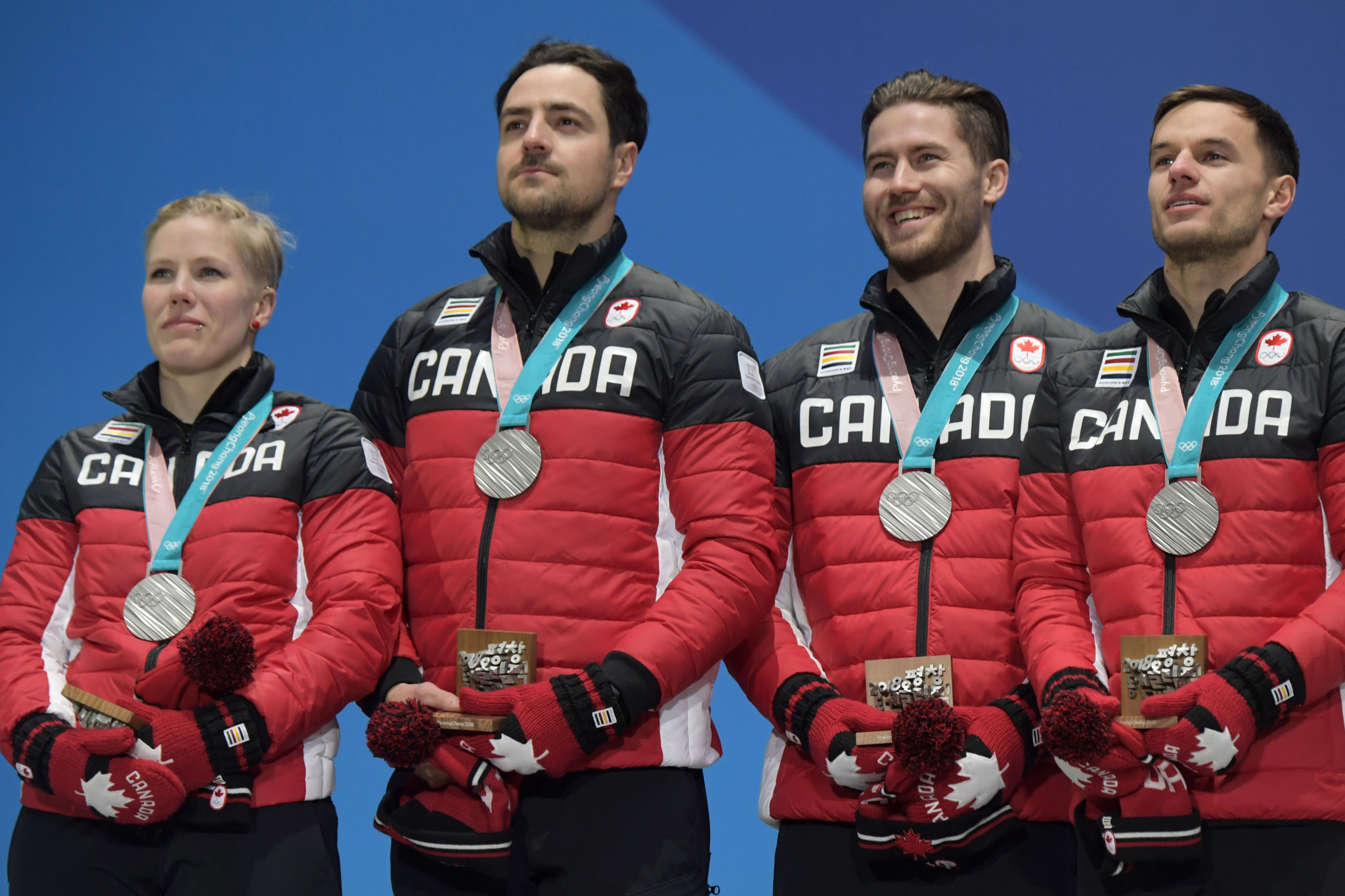 Canada's silver medallists Alex Gough, Sam Edney, Tristan Walker and Justin Snith pose on the podium during the medal ceremony at Pyeongchang 2018 ©Getty Images