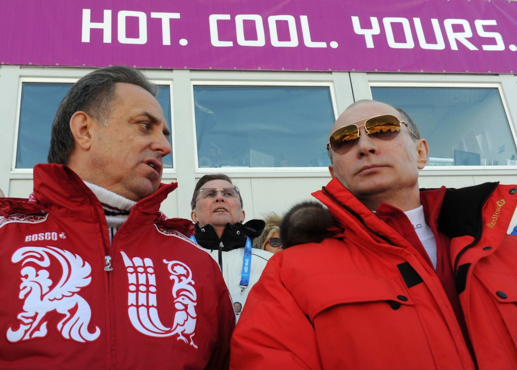 Russian President Vladimir Putin (right) appears set to stand behind long-time ally, Sports Minister Vitaly Mutko, labelled as being
