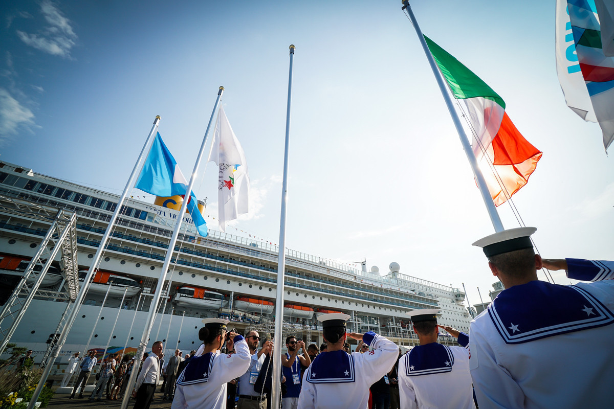 The International University Sports Federation and Italian flags were raised during the opening of the Athletes' Village for the 2019 Summer Universiade in Naples ©FISU