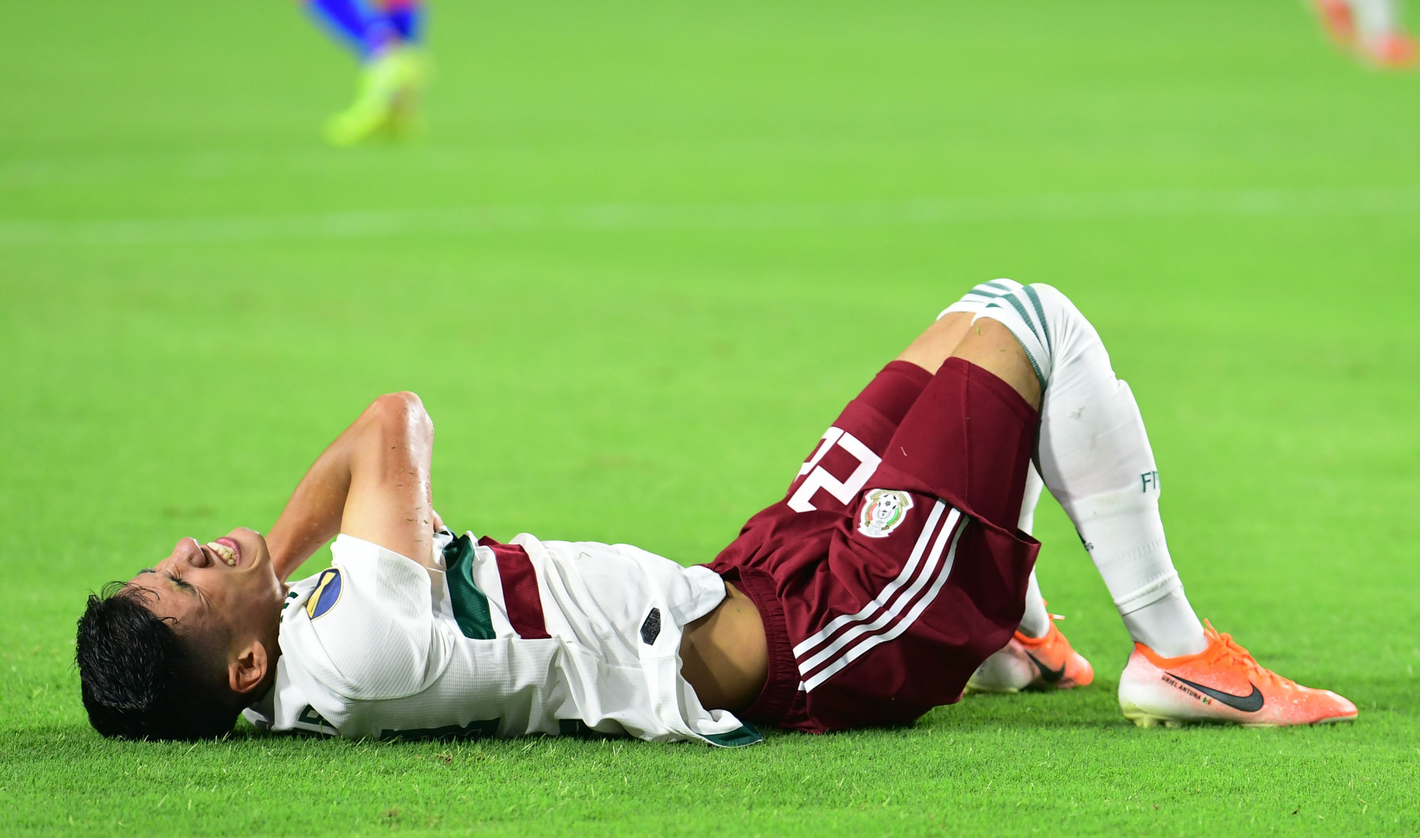 Mexico forward Uriel Antuna is in pain after taking a tumble in the CONCACAF Gold Cup final ©Getty Images