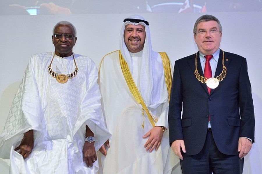Lamine Diack (left) and Thomas Bach (right) each pictured receiving ANOC Merit Awards at the 2014 ANOC General Assembly in Bangkok ©Getty Images