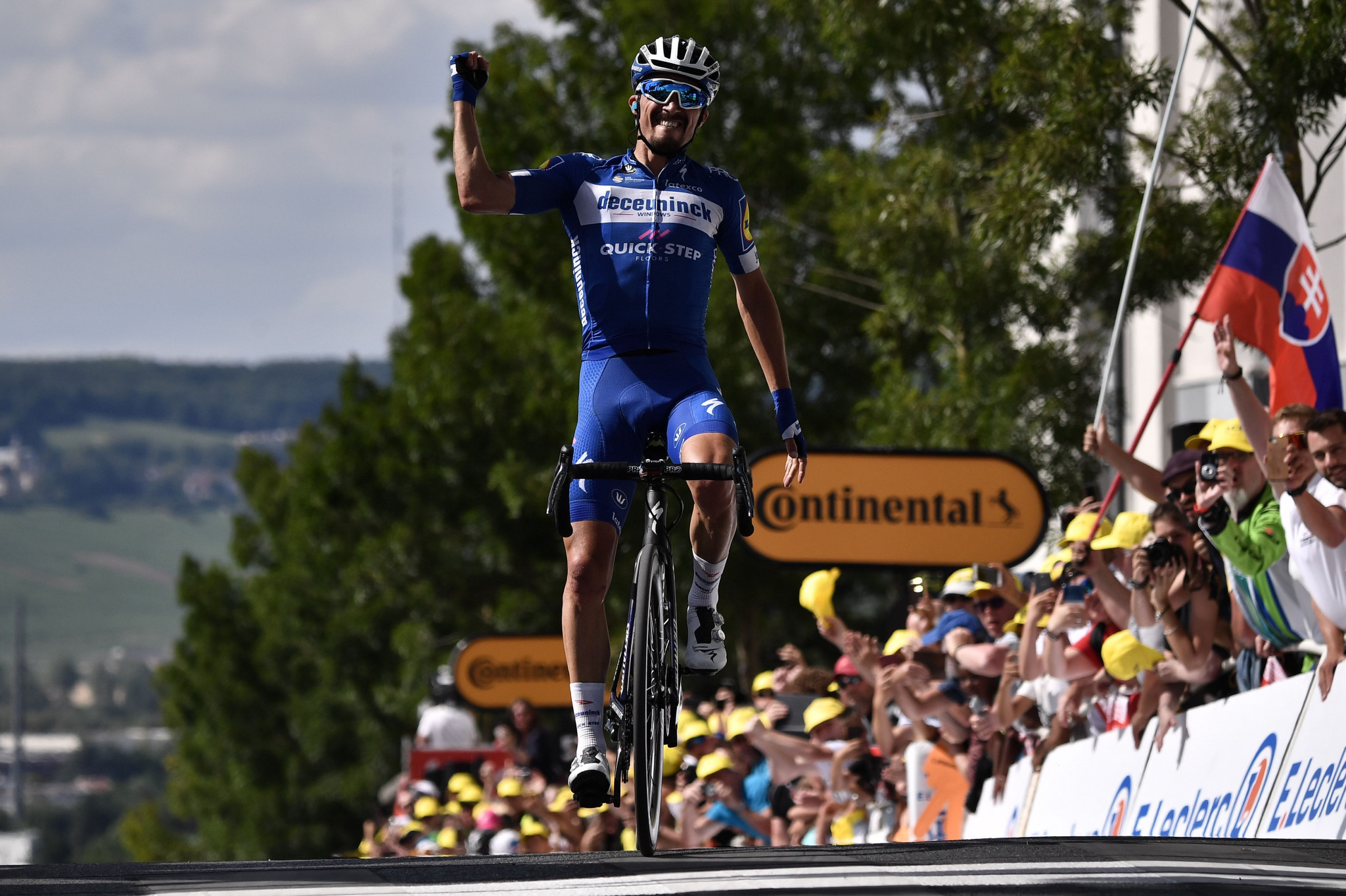Alaphilippe wins stage three of Tour de France to take overall lead