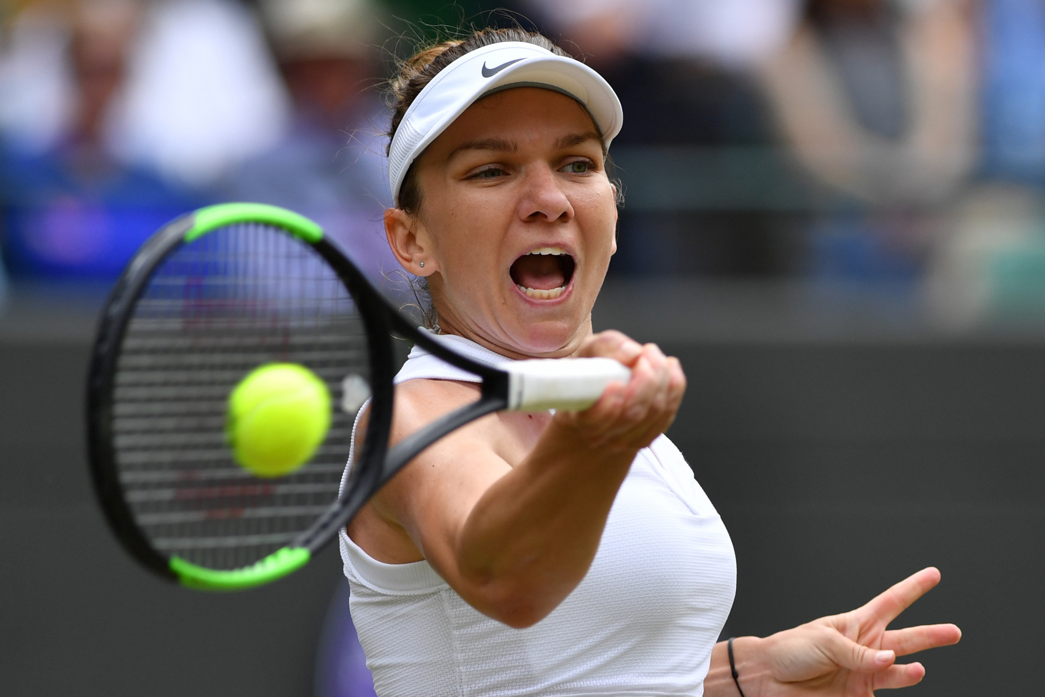 Romania's Simona Halep is through to the last four after defeating China's Zhang Shuai 7-6, 6-1 ©Getty Images
