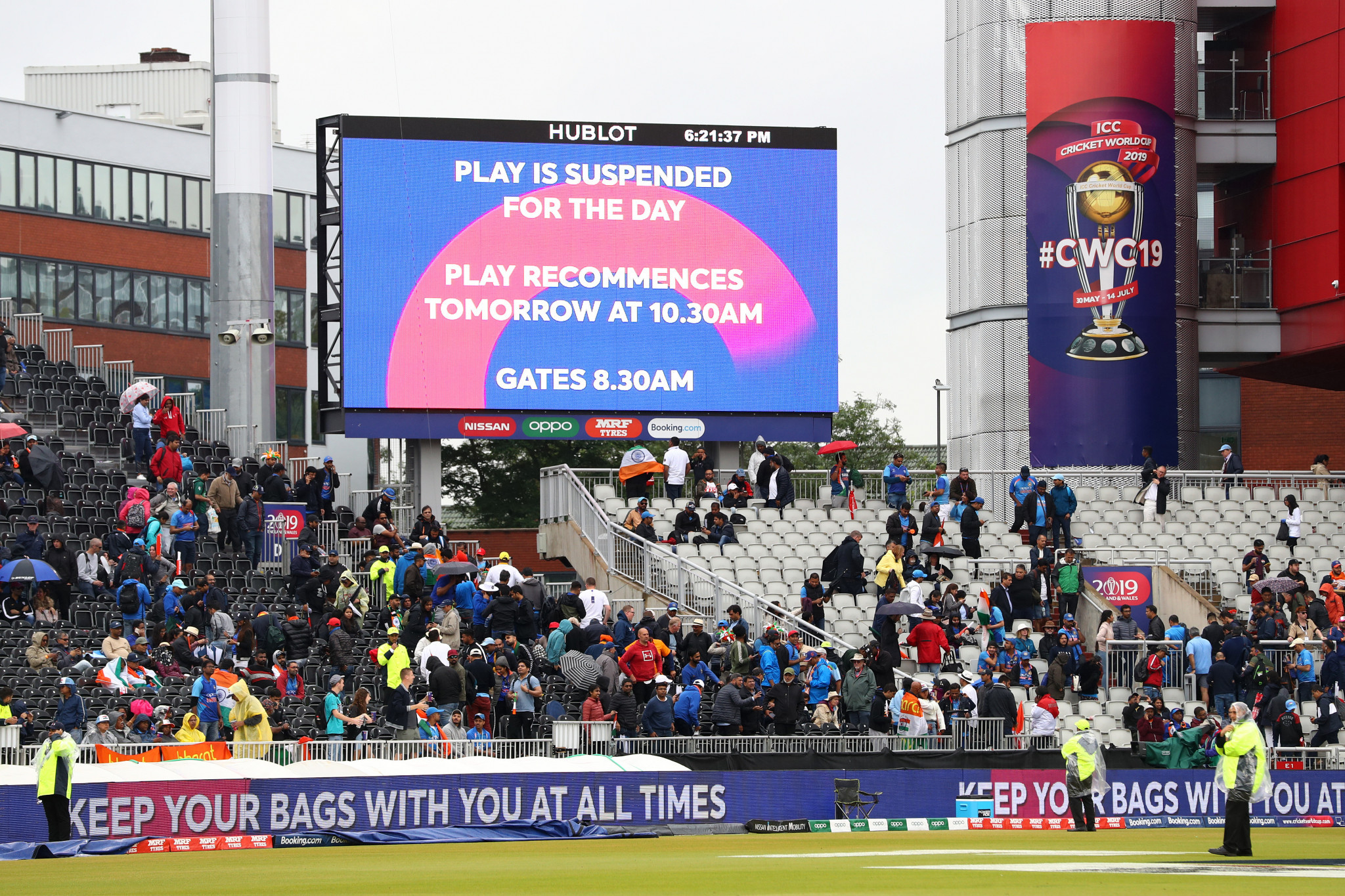 Rain forces ICC Cricket World Cup semi-final between India and New Zealand to be abandoned for day