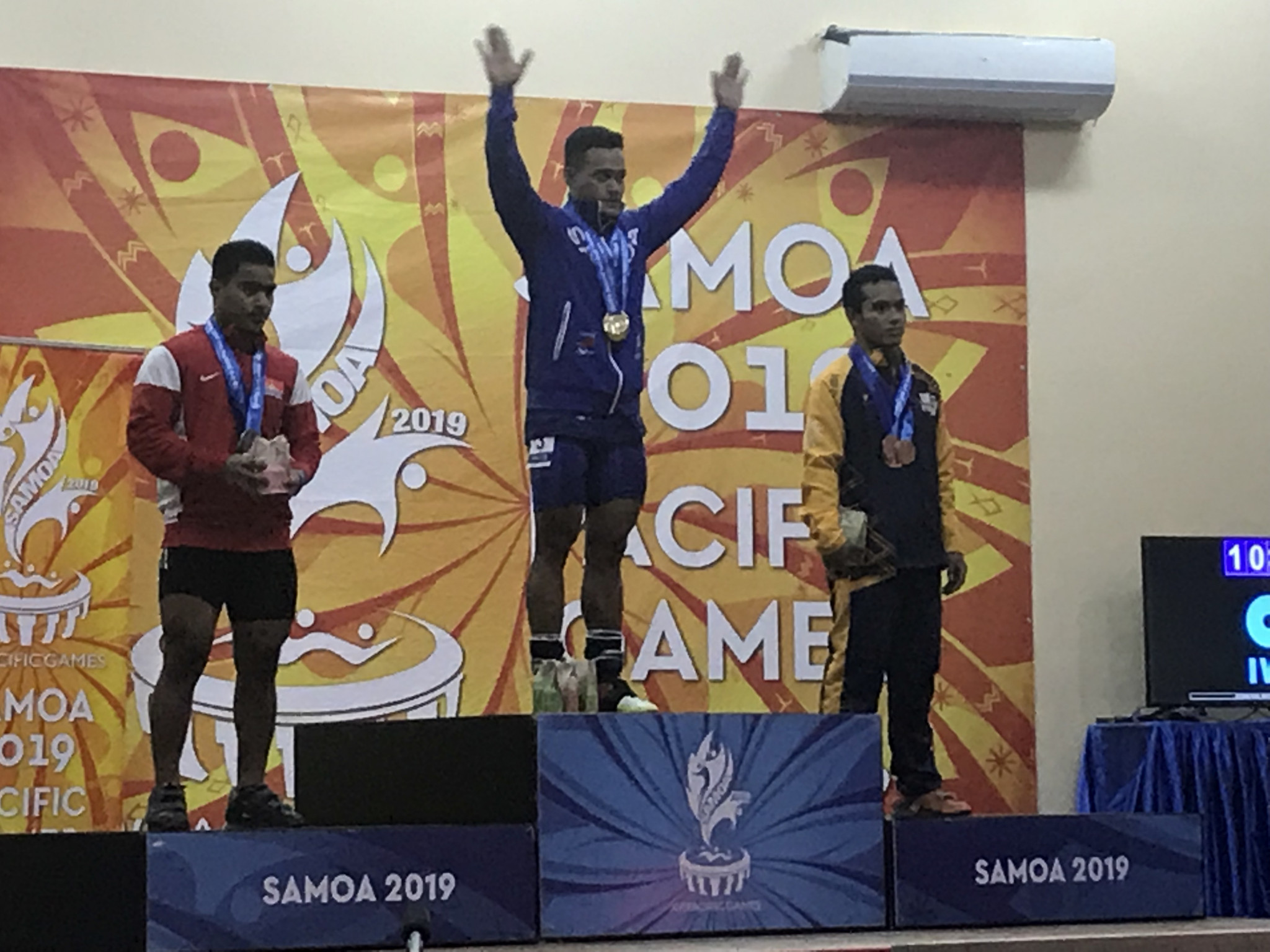 Samoa's Vaipava Nevo Ioane took all three gold medals in the men's 67kg weightlifting competition ©ITG