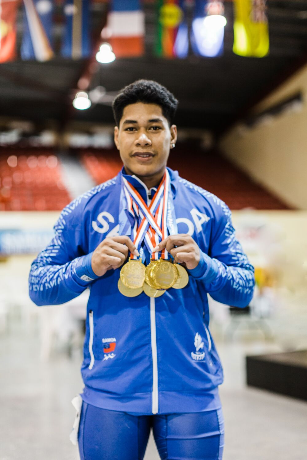 Home favourite Don Opeloge won three gold medals for Samoa in the weightlifting ©Samoa 2019