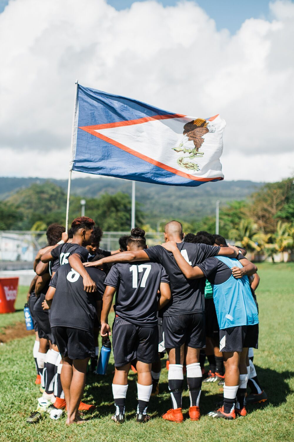 American Samoa's footballers gather in a huddle before their 1-1 draw with Tuvalu ©Samoa 2019