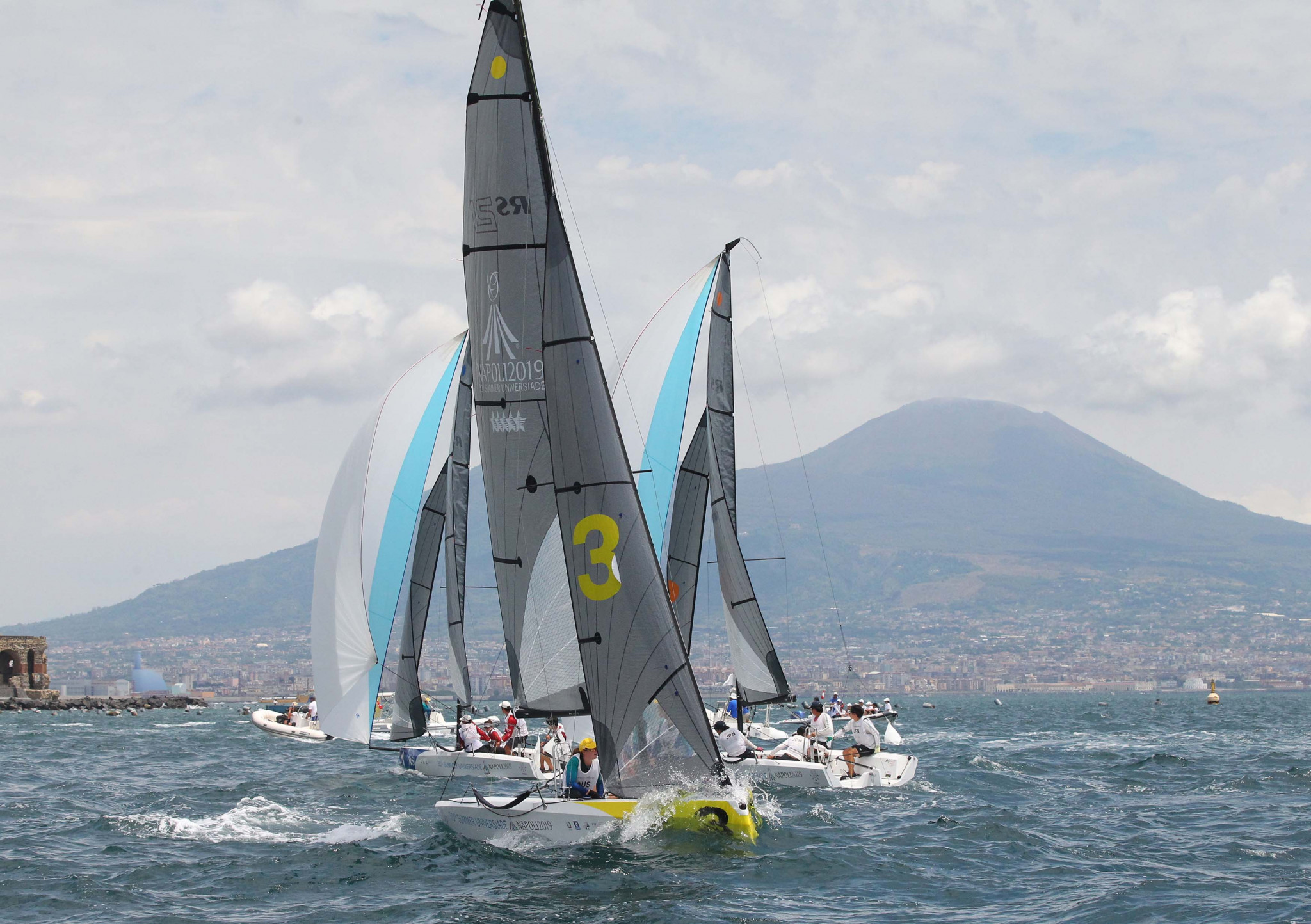 Sailors compete in the mixed fleet racing in the Bay of Naples ©Naples 2019