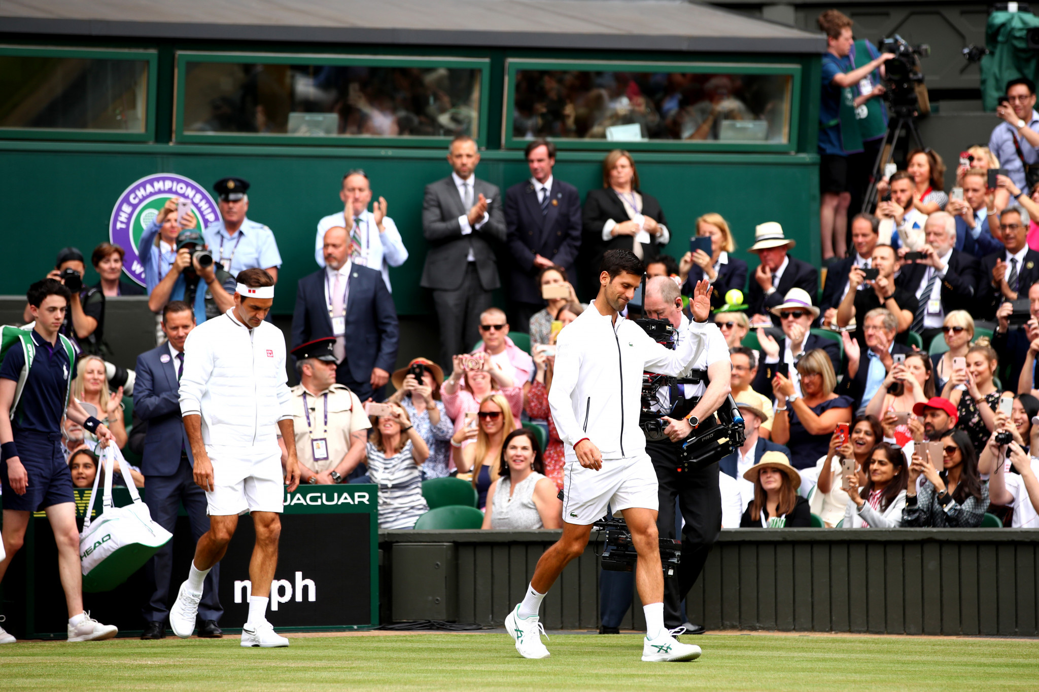 The scene was set for a Centre Court classic as Djokovic and Federer entered the arena ©Getty Images