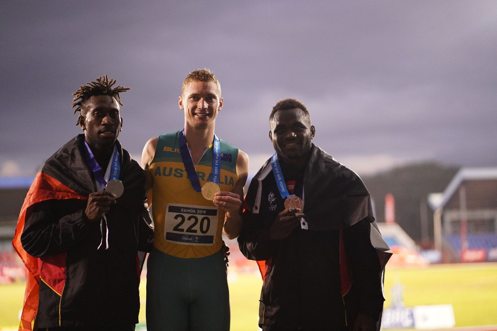 Steven Solomon poses with his gold medal after breaking the Pacific Games men's 400m record ©Games News Service
