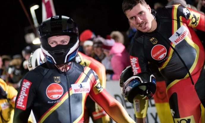 Bobsleigh push athlete Jannis Bäcker, right, has called time on his career ©IBSF