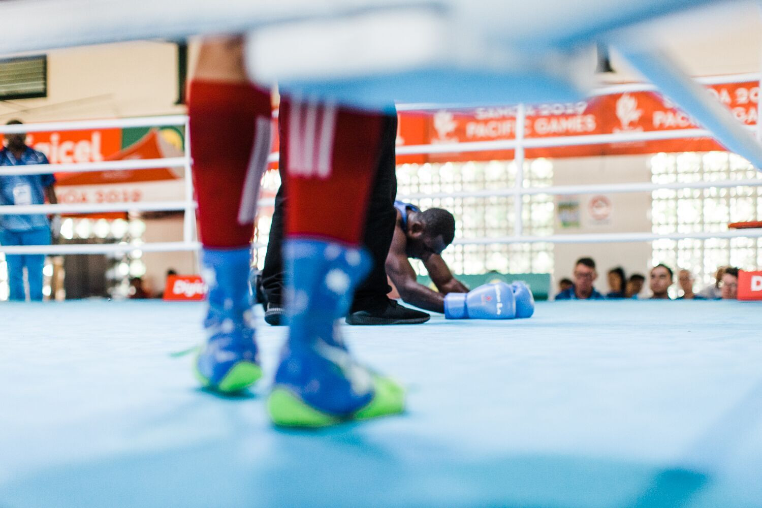 A beaten boxer takes in his defeat on the canvas after his fight in Samoa ©Games News Service