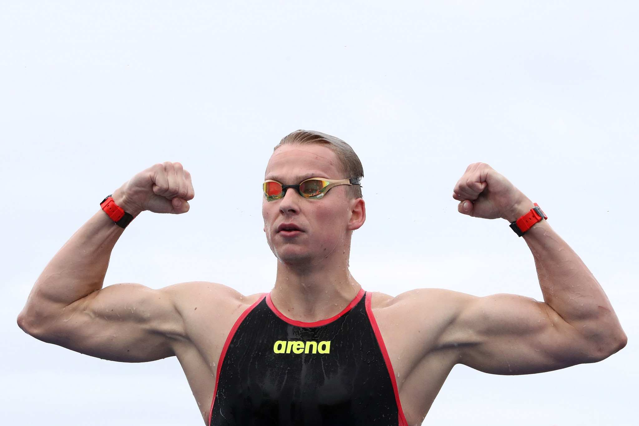 Rob Muffels celebrates after Germany won the team open water event ©Getty Images