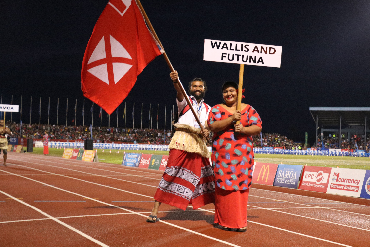 Flagbearers appeared first with athletes following later in the parade ©Pacific Games News Service