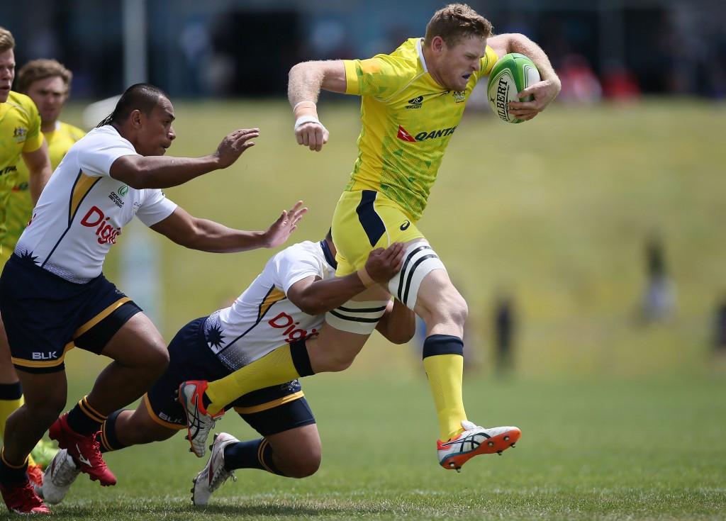 Tom Cusack of Australia evades a Nauru tackle in Auckland