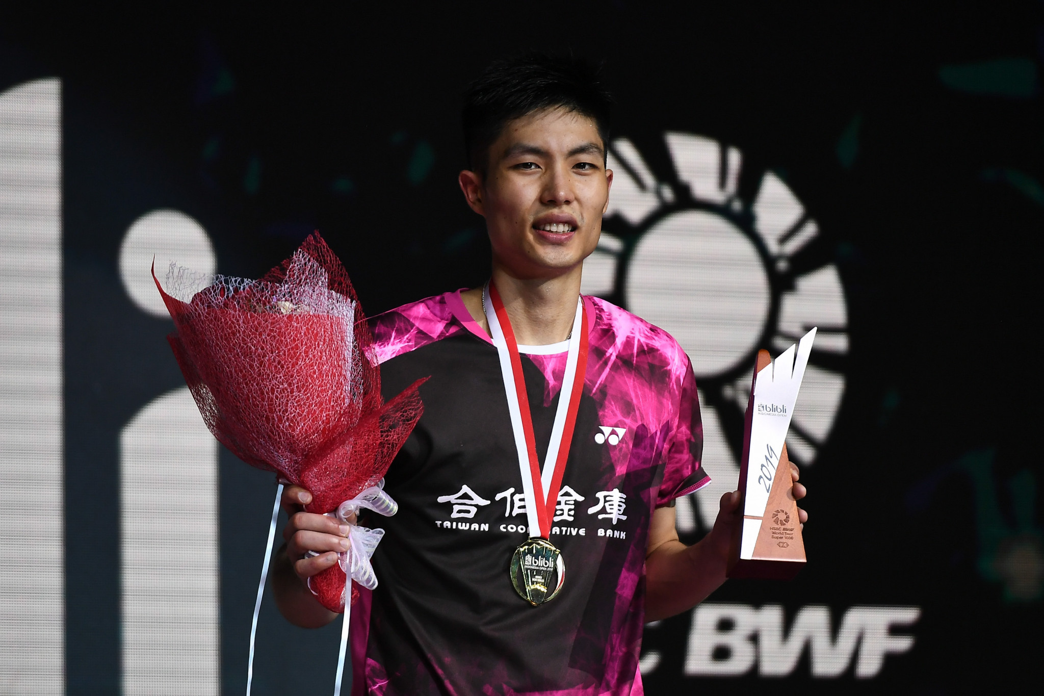 Chou and Yamaguchi seal titles at BWF Indonesia Open
