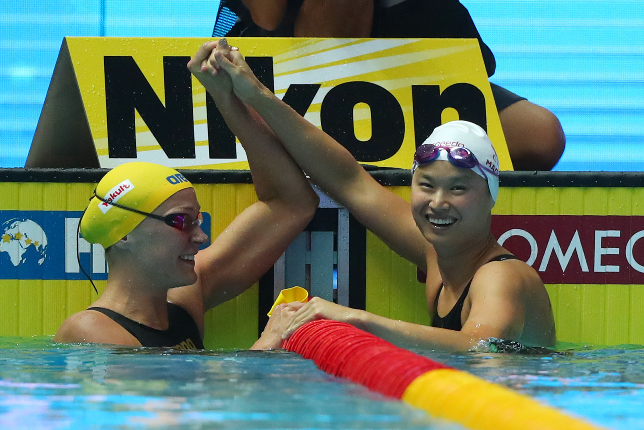 Canada's Maggie MacNeil, right, and Sarah Sjöström of Sweden were all smiles after claiming gold and silver medals respectively in the women's 100m butterfly final in Gwangju ©Getty Images
