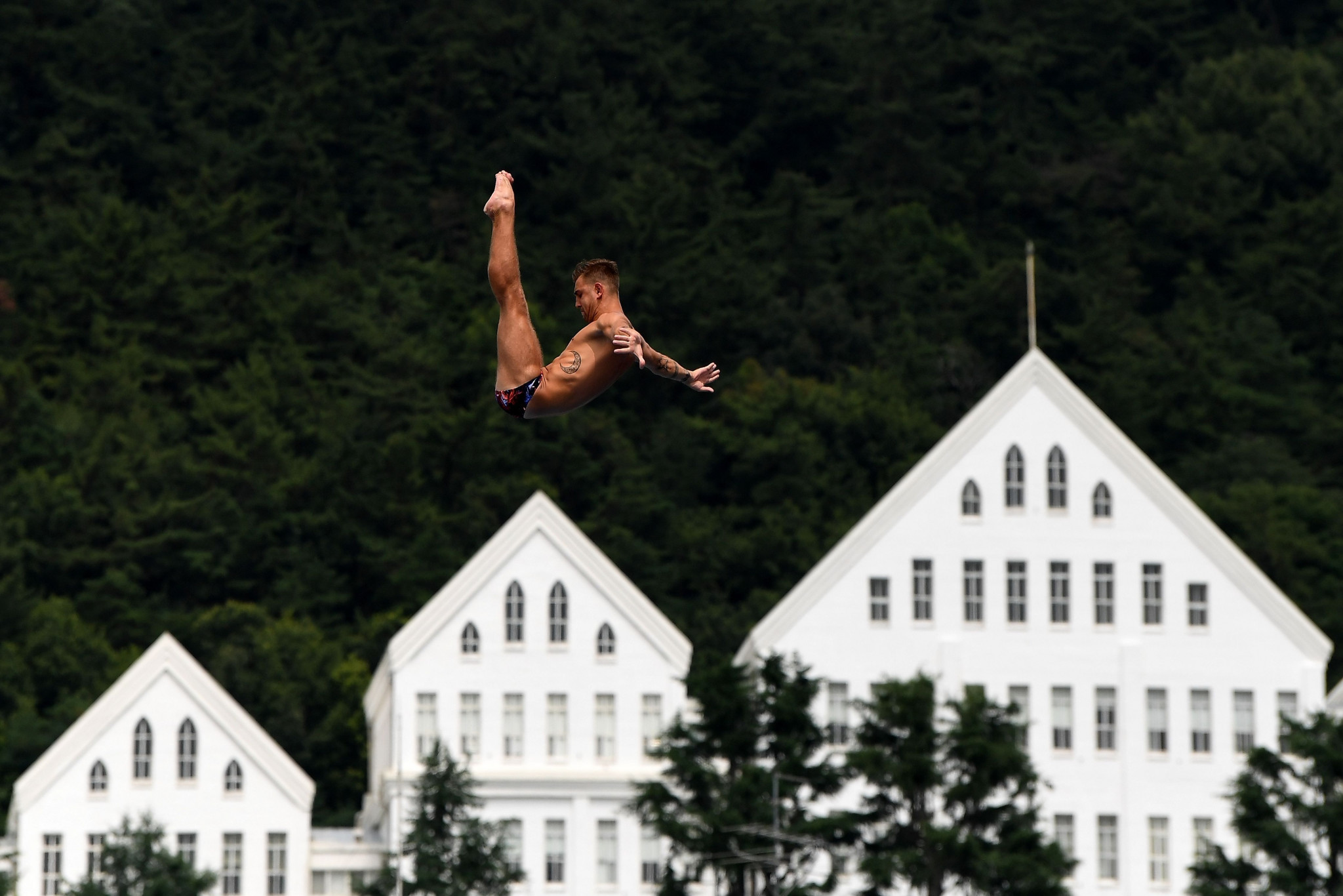 Russia's Nikita Fedotov competes in a round of the men's high diving event at Chosun University in Gwangju ©Getty Images
