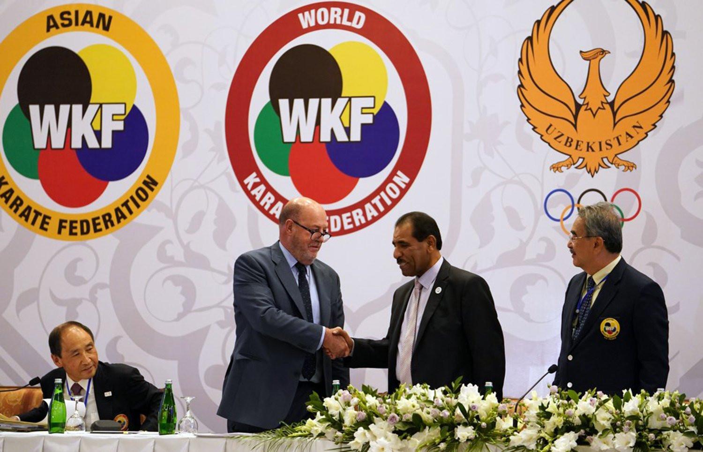 WKF President Antonio Espinós , left, congratulates Nasser Alrarazooqi on being elected President of the Asian Karate Federation ©WKF