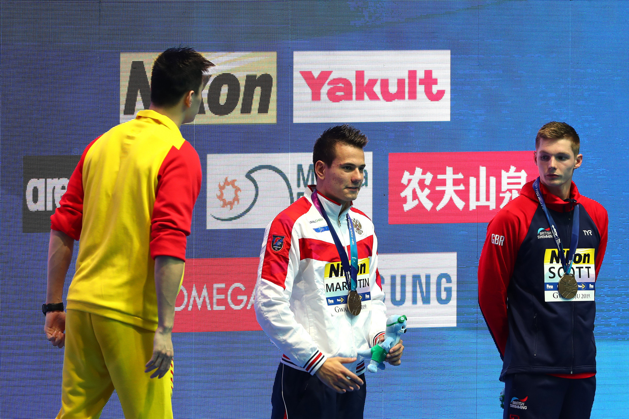 Sun Yang screams at Duncan Scott during the medal ceremony with both swimmers due to receive written warnings from FINA ©Getty Images