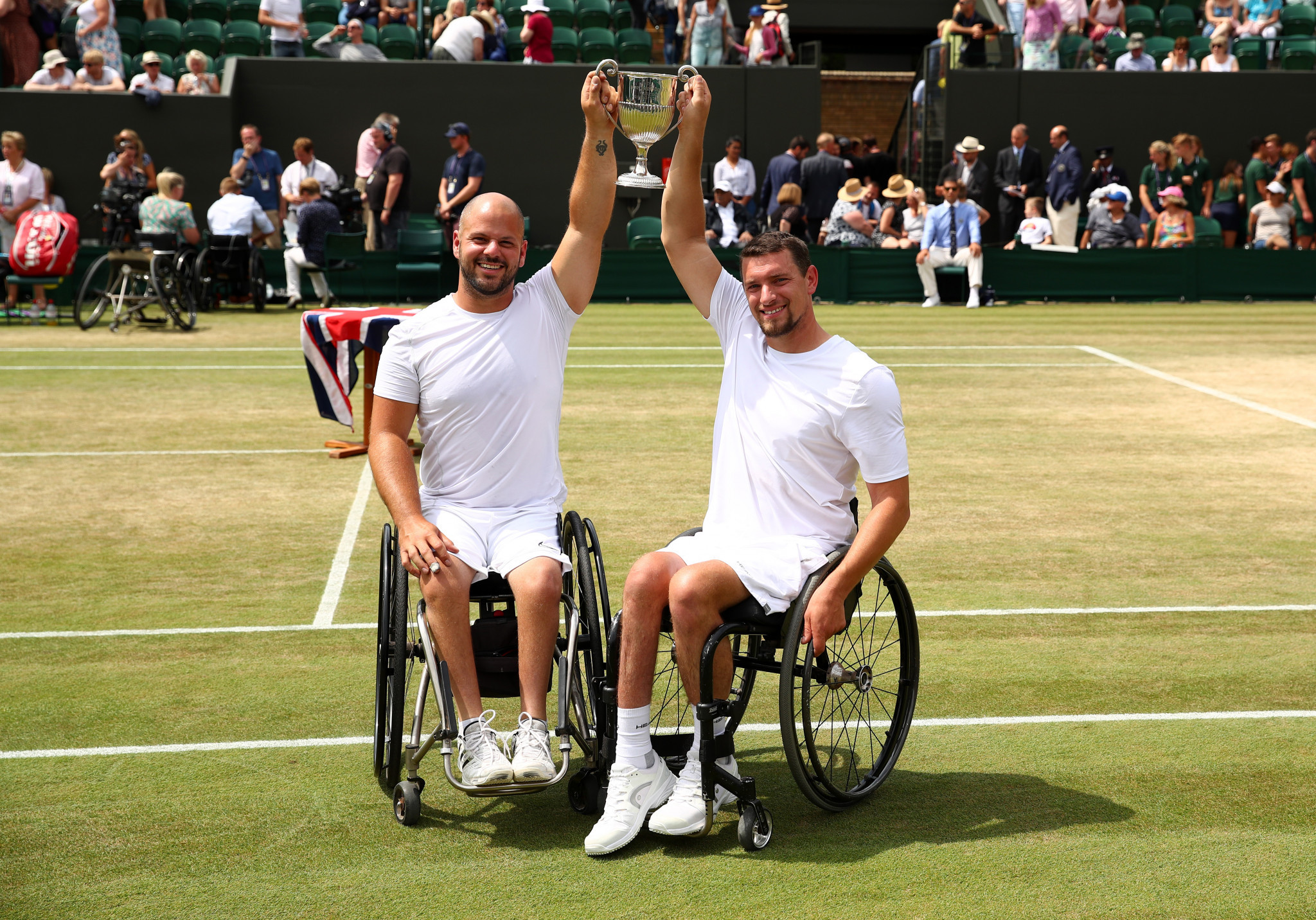 Joachim Gerard of Belgium and Sweden's Stefan Olsson celebrate victory in the men's wheelchair tennis doubles final at Wimbledon ©Getty Images