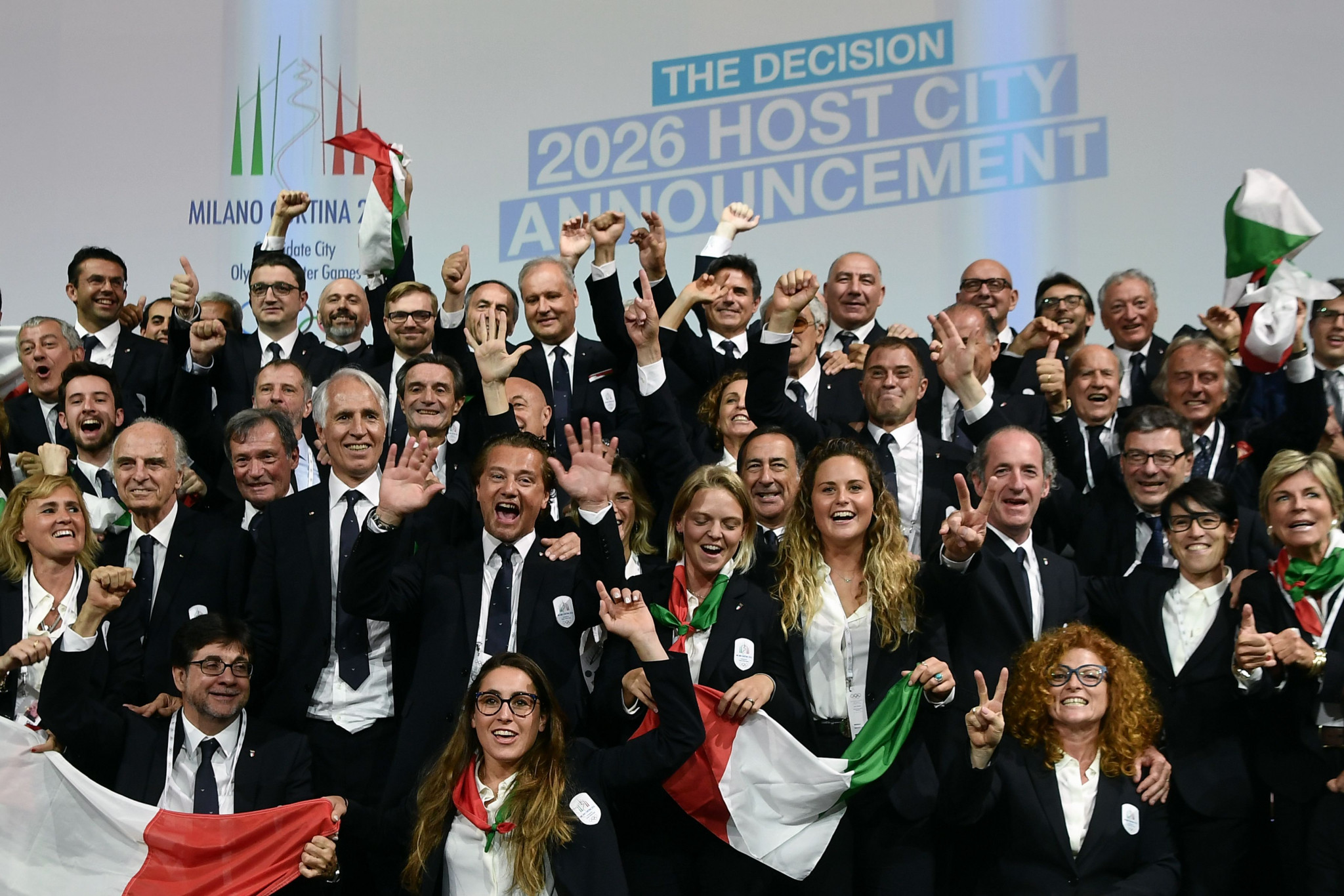 Members of the delegation of Milan/Cortina d'Ampezzo 2026 Winter Olympics candidate city react after the cities were selected to host the 2026 Olympic Winter Games ©Getty Images