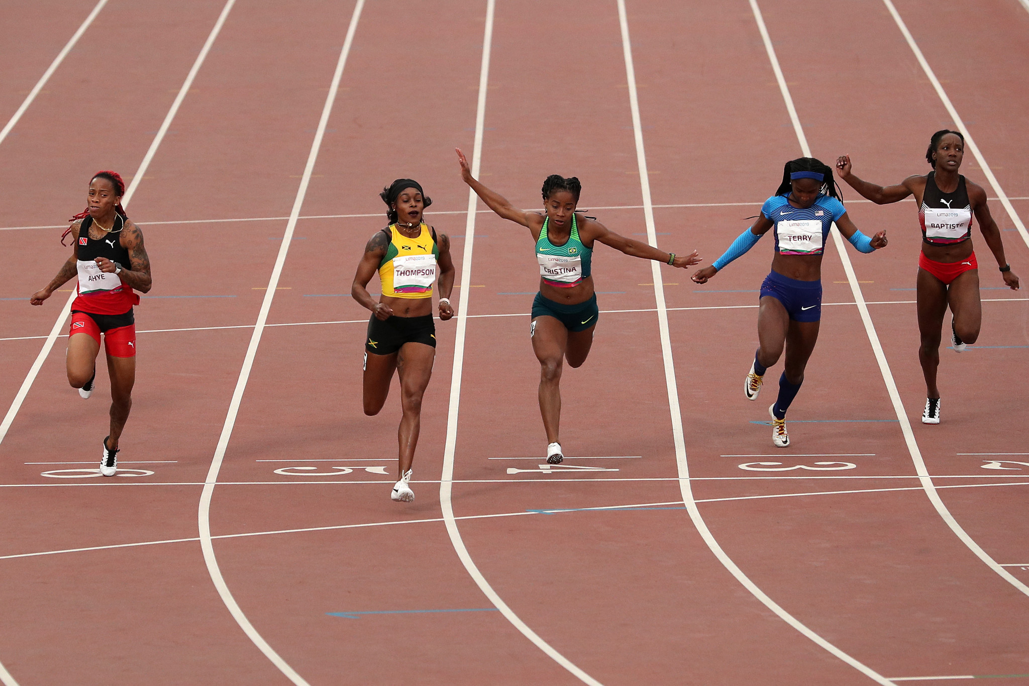 Olympic champion Thompson storms to women's 100m title at Lima 2019