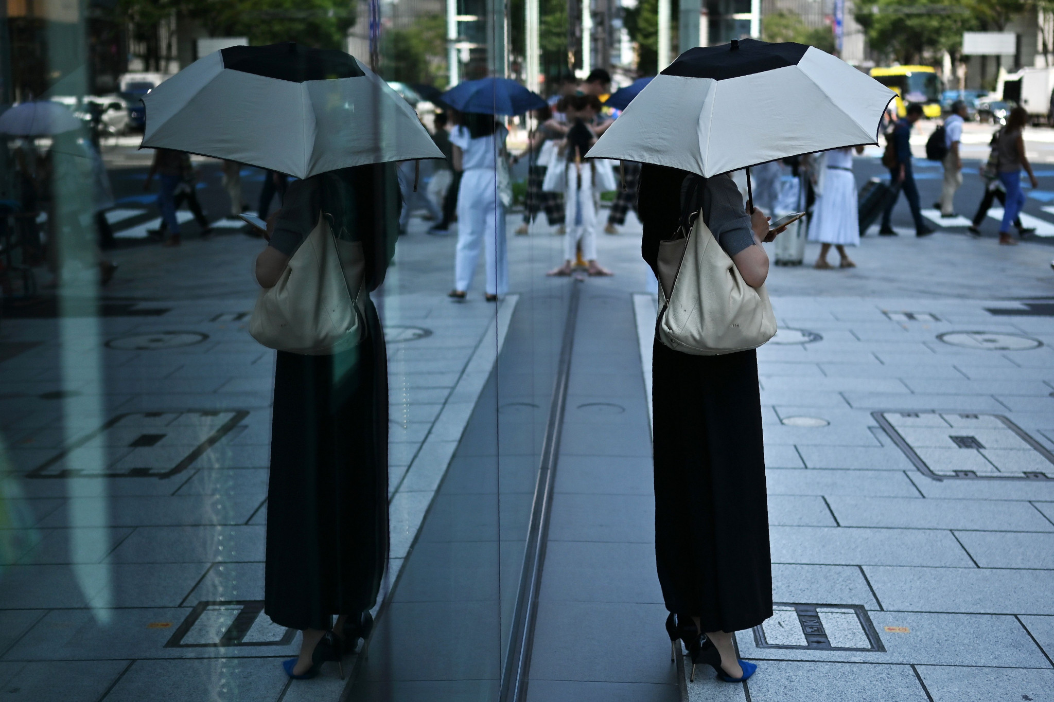 People in Japan have resorted to using umbrellas to shield themselves from soaring temperatures ©Getty Images