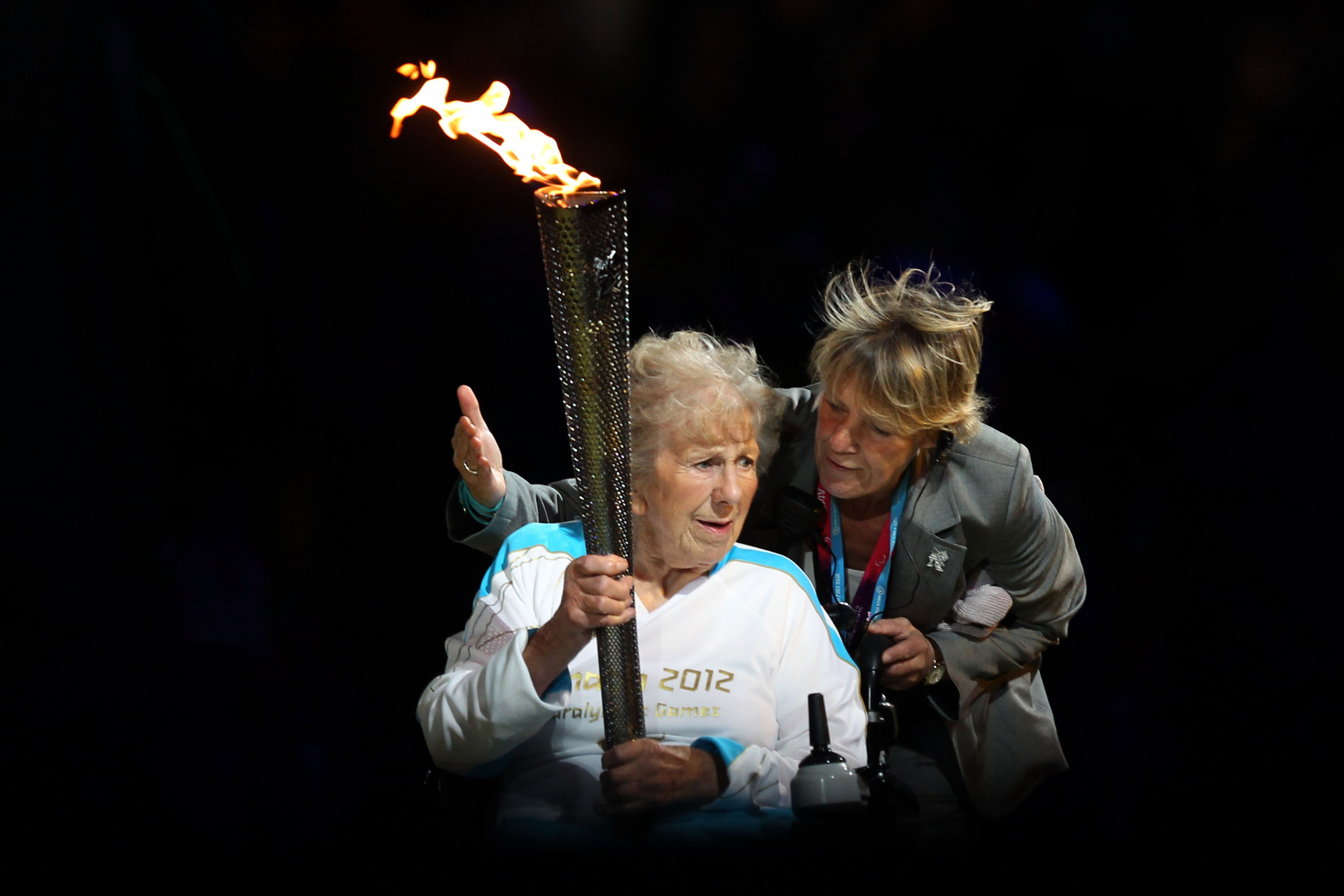 Paralympian Margaret Maughan carries the flame during the Opening Ceremony of the London 2012 Paralympics at the Olympic Stadium ©Getty Images