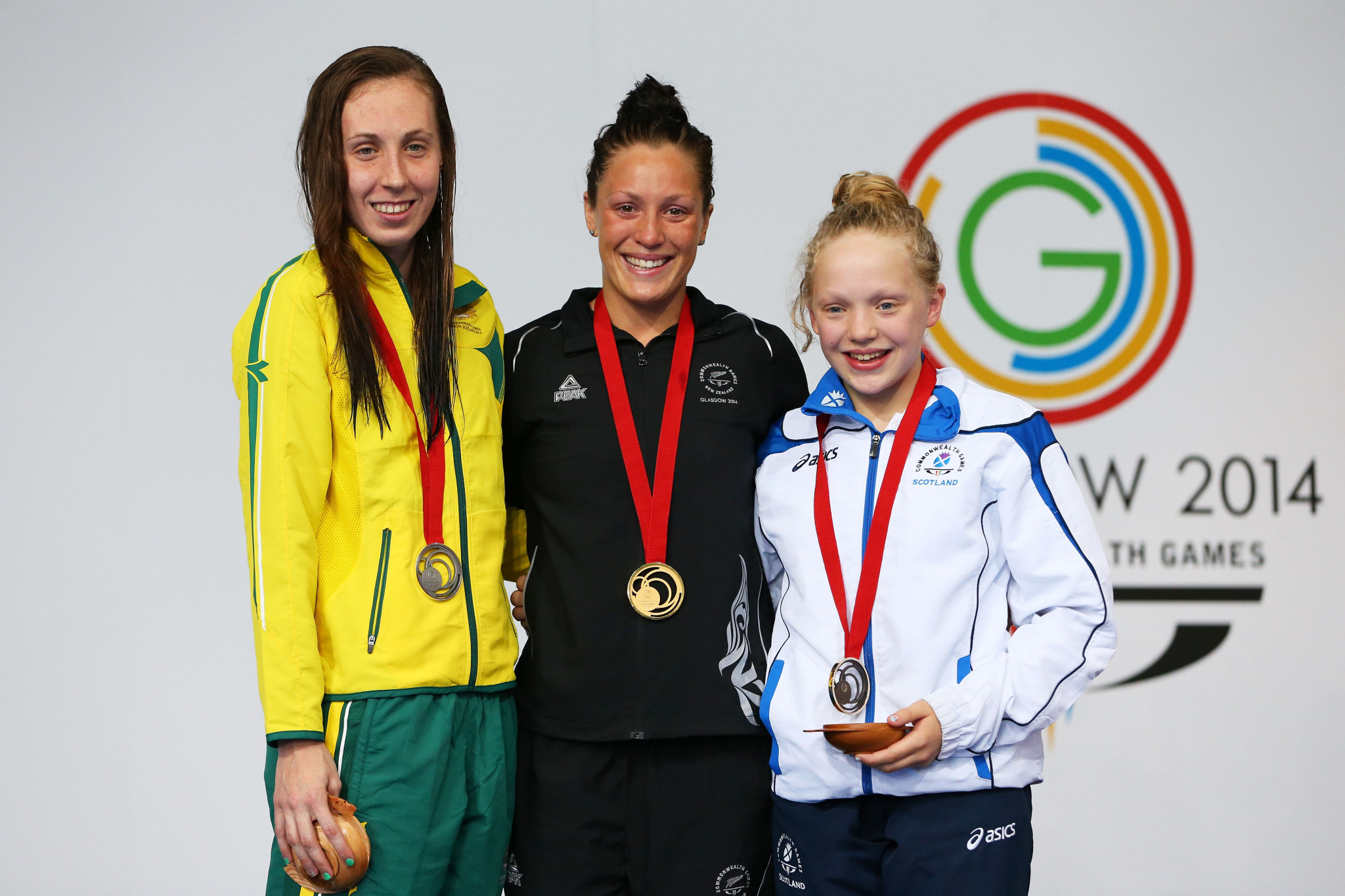 Gold medallist Sophie Pascoe of New Zealand poses with silver medallist Madeleine Scott of Australia and bronze medallist Erraid Davies of Scotland during the medal ceremony for the Women's 100m Breaststroke SB9 Final at Tollcross International Swimming Centre ©Getty Images