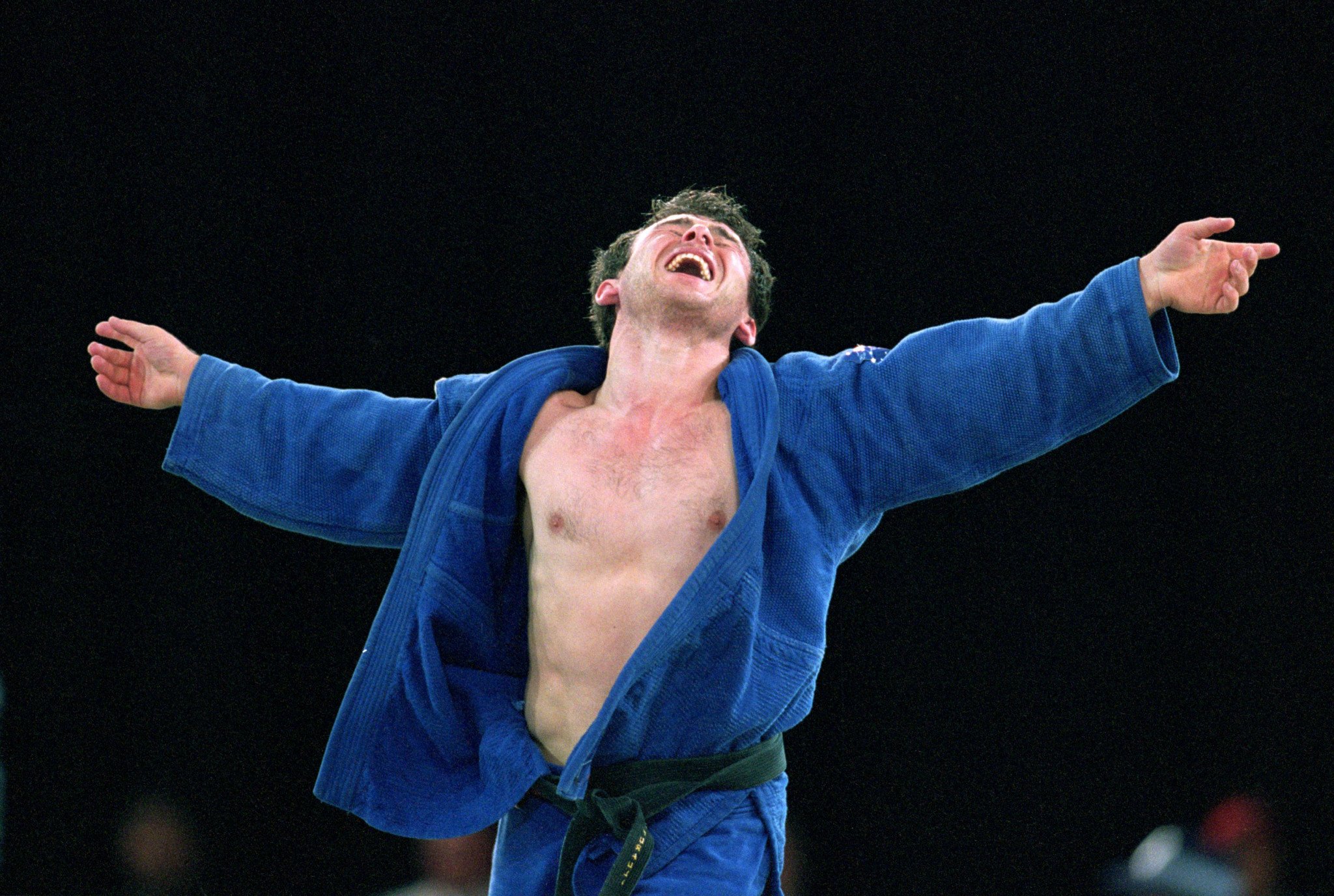Giorgi Vazagashvili of Georgia celebrates bronze in the Men's 66kg Judo event at the Exhibition Halls in Darling Harbour on Day Two of the Sydney 2000 Olympic Games in Sydney, Australia ©Getty Images
